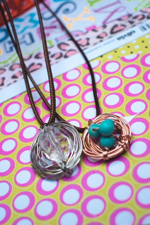 Wrap beads in wire loosely and slide on to leather necklace.