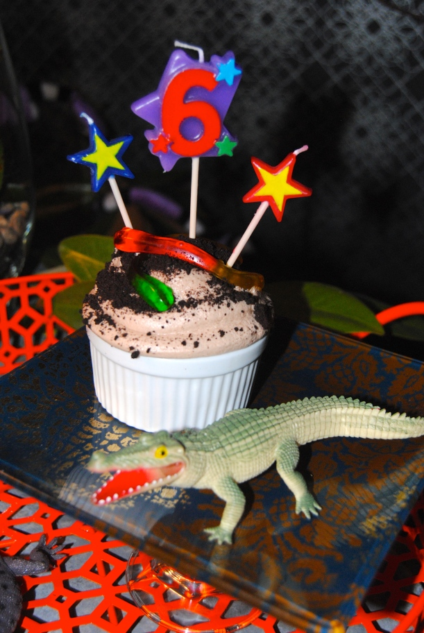 "Vanilla Cupcakes, homemade chocolate malted milk icing, Oreo crumb ""dirt"" and gummy rattlesnakes! Mmmmm. I mean, Sssssss!"