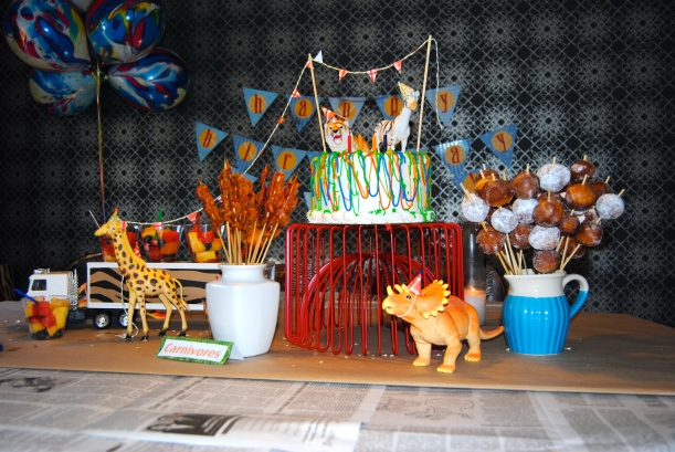 table scape bacon on a stick donut holes animal cake